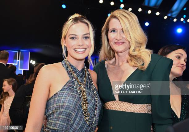 Australian actress Margot Robbie and US actress Laura Dern pose during the 26th Annual Screen Actors Guild Awards show at the Shrine Auditorium in...