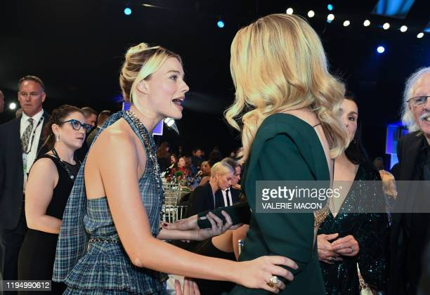 Australian actress Margot Robbie and US actress Laura Dern talk during the 26th Annual Screen Actors Guild Awards show at the Shrine Auditorium in...