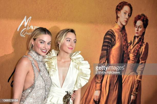 Australian actress Margot Robbie and USIrish actress Saoirse Ronan attend the New York premiere of 'Mary Queen Of Scots' at Paris Theater on December...