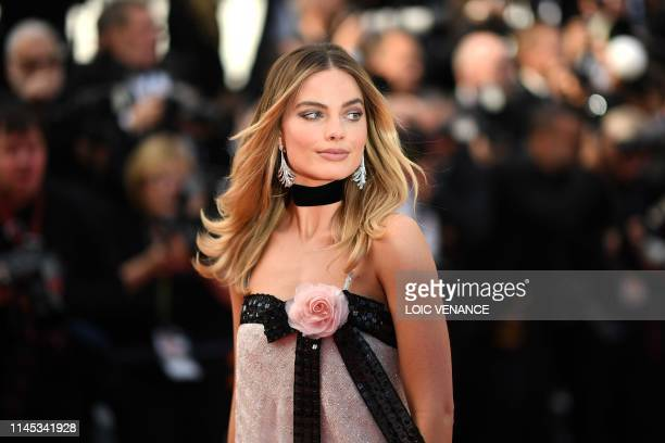 Australian actress Margot Robbie poses as she arrives for the screening of the film Once Upon a Time in Hollywood at the 72nd edition of the Cannes...