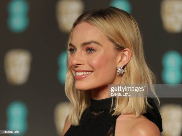 Australian actress Margot Robbie poses on the red carpet upon arrival at the BAFTA British Academy Film Awards at the Royal Albert Hall in London on...