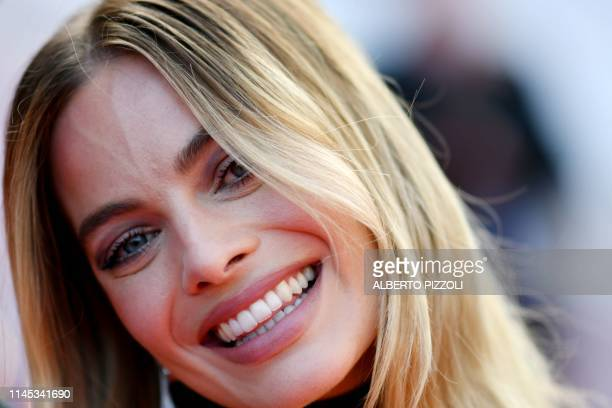 Australian actress Margot Robbie smiles as she arrives for the screening of the film Once Upon a Time in Hollywood at the 72nd edition of the Cannes...