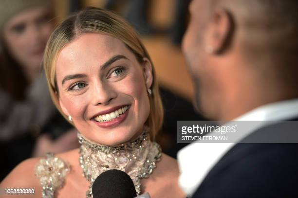 Australian actress Margot Robbie speaks with the press at the New York premiere of 'Mary Queen Of Scots' at Paris Theater on December 4 2018 in New...