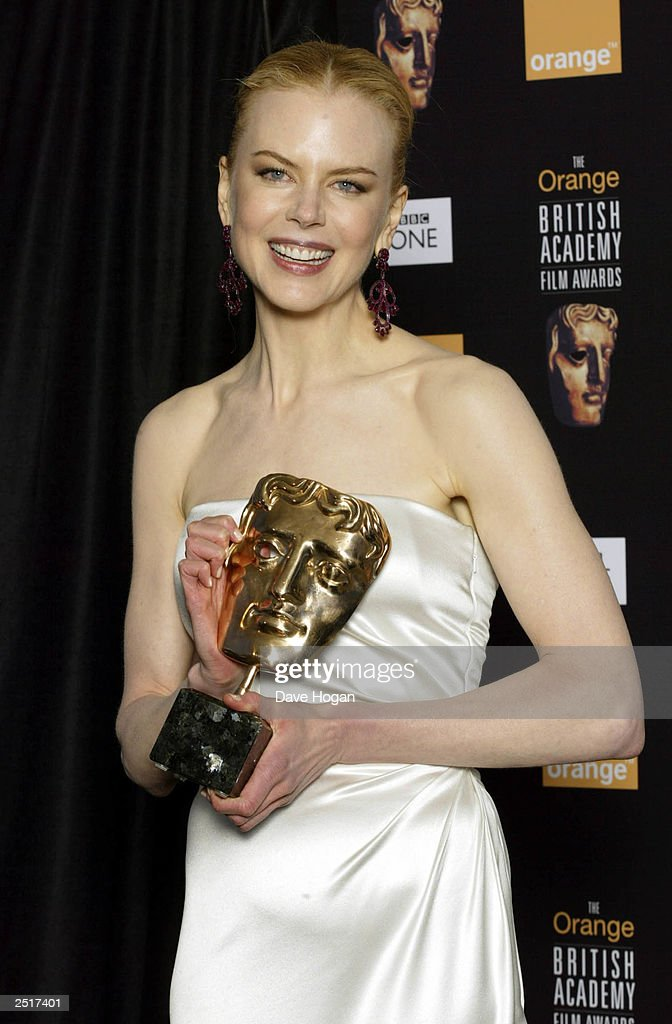 Australian actress Nicole Kidman accepts the award for 'Performance by an Actress in a Leading Role' for her film 'The Hours' at the 2003 Orange British Academy Film Awards 'The BAFTAS' Held At The Odeon, Leicester Square on February 23, 2003 in London.