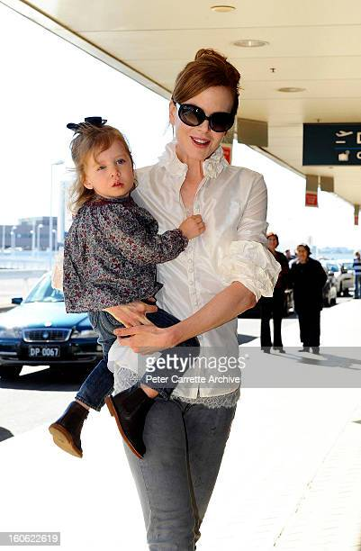 Australian actress Nicole Kidman and her daughter Sunday Rose arrive at Sydney airport to board a flight to Los Angeles on June 20 2010 in Sydney...