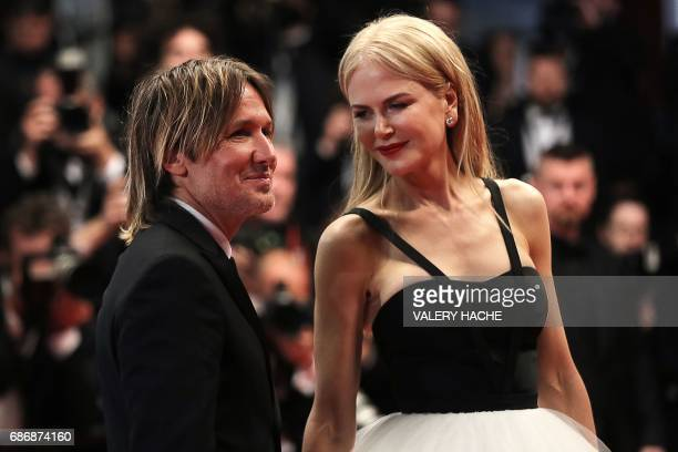 Australian actress Nicole Kidman and her husband Australian country singer Keith Urban pose as they leave the Festival Palace on May 22 2017...
