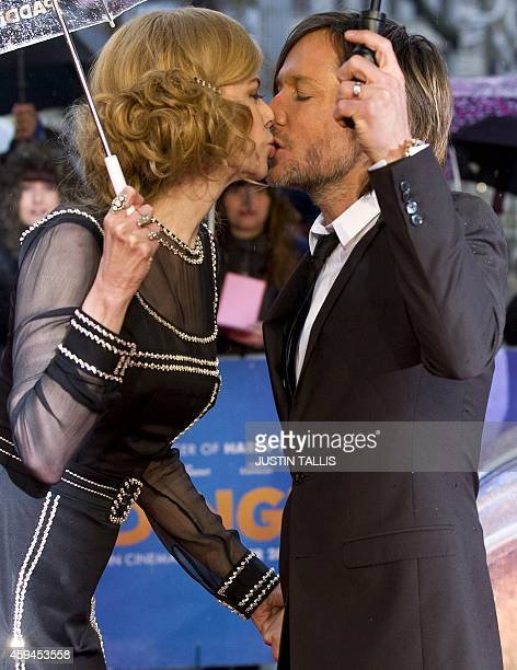 Australian actress Nicole Kidman and her husband musician Keith Urban kiss as they pose for pictures on the red carpet upon arrival for the world...
