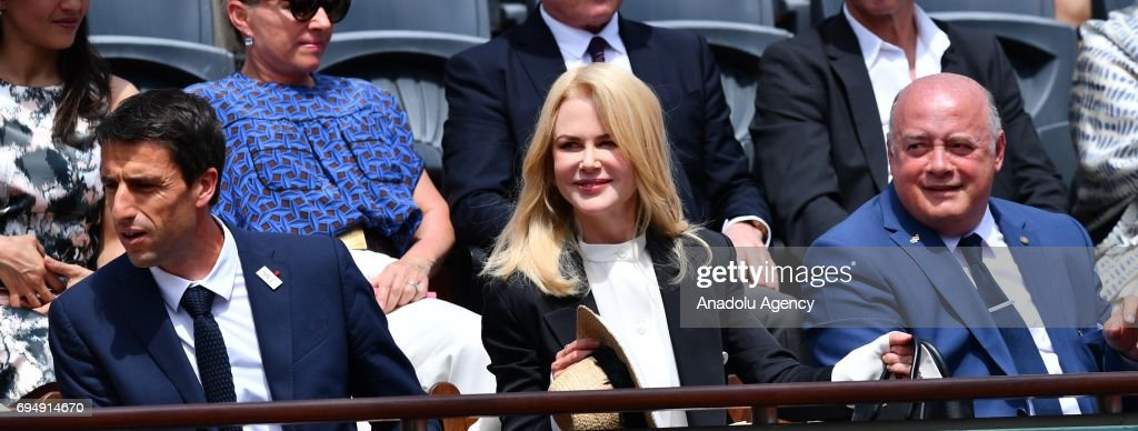 Australian actress Nicole Kidman (C) and Tony Estanguet (L), co-chairman of the Paris 2024 Organising Committee and Bernard Giudicelli (R), the President of the French Tennis Federation attend for the men's final match between Stan Wawrinka of Switzerland and Rafael Nadal of Spain at the Roland Garros stadium in Paris, France on June 11, 2017.