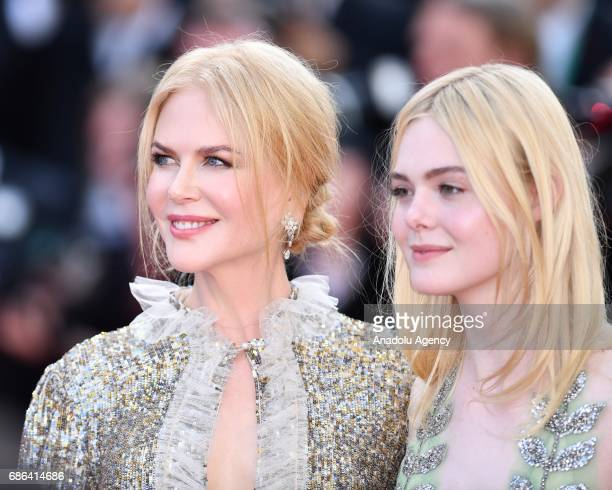Australian actress Nicole Kidman and US actress Elle Fanning leave after screening of the film How to talk to girls at parties out of competition at...