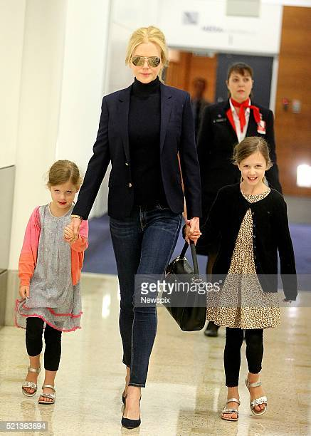 Australian actress Nicole Kidman arrives with her daughters Sunday Rose and Faith Margaret at Sydney Airport in Sydney New South Wales