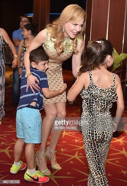 Australian actress Nicole Kidman gets a hugs from a young boy before a special screening of her new film Paddington for children being treated at...