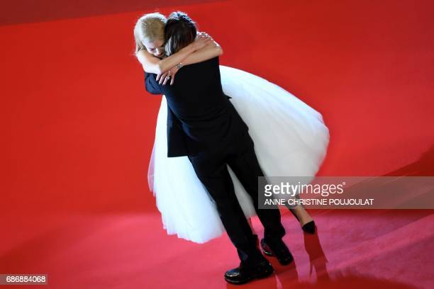 TOPSHOT Australian actress Nicole Kidman hugs her husband Australian country singer Keith Urban as they leave the Festival Palace on May 22 2017...
