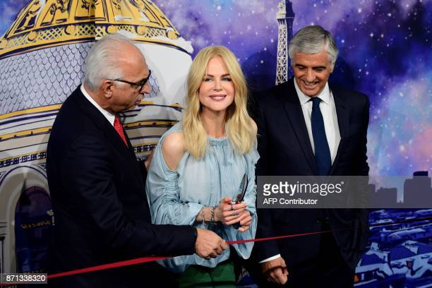 Australian actress Nicole Kidman is about to cut the ribbon next to President and CEO of Le Printemps Paolo De Cesare and LVMH Group Managing...