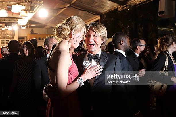 """Australian actress Nicole Kidman leaves with husband Keith Urban after the screening of """"The Paperboy"""" presented in competition at the 65th Cannes..."""