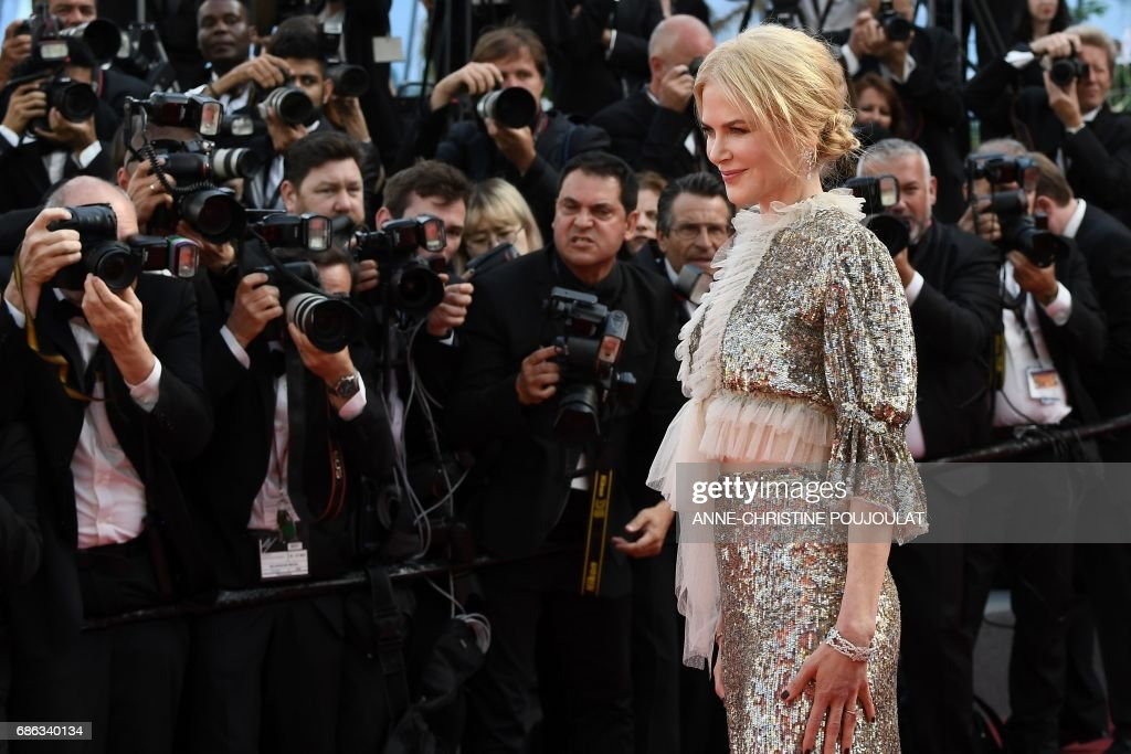 Australian actress Nicole Kidman poses before leaving the Festival Palace on May 21, 2017 following the screening of the film 'How to talk to Girls at Parties' at the 70th edition of the Cannes Film Festival in Cannes, southern France. / AFP PHOTO / Anne-Christine POUJOULAT