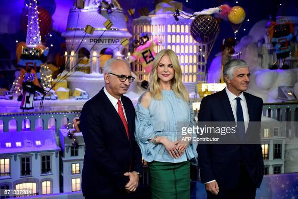 Australian actress Nicole Kidman President and CEO of Le Printemps Paolo De Cesare and LVMH Group Managing Director Antonio Belloni pose as they...
