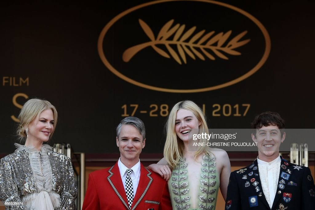 Australian actress Nicole Kidman, US director John Cameron Mitchell US actress Elle Fanning and British actor Alex Sharp pose before leaving the Festival Palace on May 21, 2017 following the screening of the film 'How to talk to Girls at Parties' at the 70th edition of the Cannes Film Festival in Cannes, southern France. / AFP PHOTO / Anne-Christine POUJOULAT
