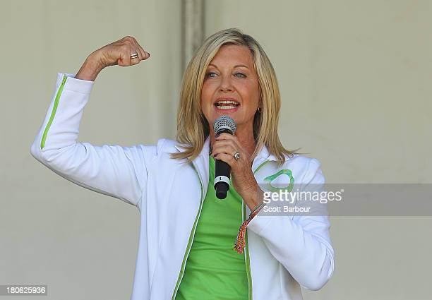 Australian actress Olivia NewtonJohn performs her song 'Physical' on stage before leading the inaugural Wellness Walk on September 15 2013 in...