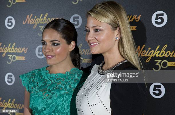 Australian actresses Olympia Valance and her sister Holly Valance pose for photographers as they arrive for the Neighbours Turns 30 celebration...