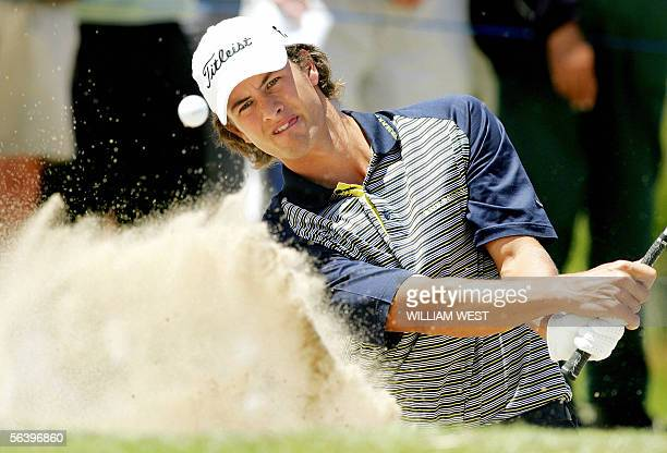 Australian Adam Scott blasts a ball out of a bunker in the second round of the Australian Masters at the Huntingdale course in Melbourne, 09 December...