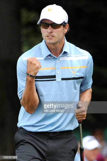 Australian Adam Scott celebrates sinking a punch during their President's Cup tournament match played at the Royal Melbourne golf course in Melbourne...