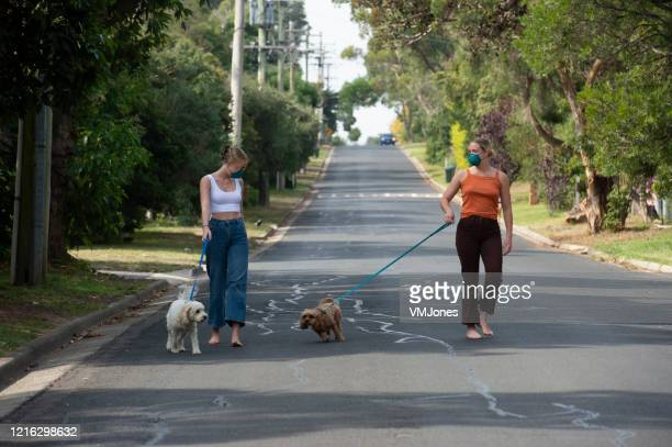 australian adults covid 19 social distancing - social distancing stock pictures, royalty-free photos & images