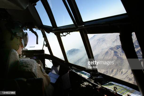 Australian airforce pilots fly the Hercules C130J on flight from the UAE Australian airbase to Kandahar airfield in Afghanistan