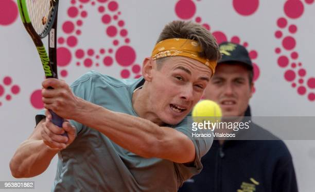Australian Alex De Minaur returns a ball to ATP 23 seed Kyle Edmund of Great Britain during the first match of the day of the 2018 Millennium Estoril...