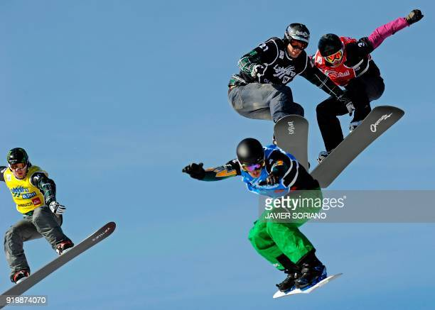 Australian Allex Pullin US Nate Holland US Seth Wescott and Italian Luca Matteotti compete in the Border Cross men final of the FIS Snowboarding...