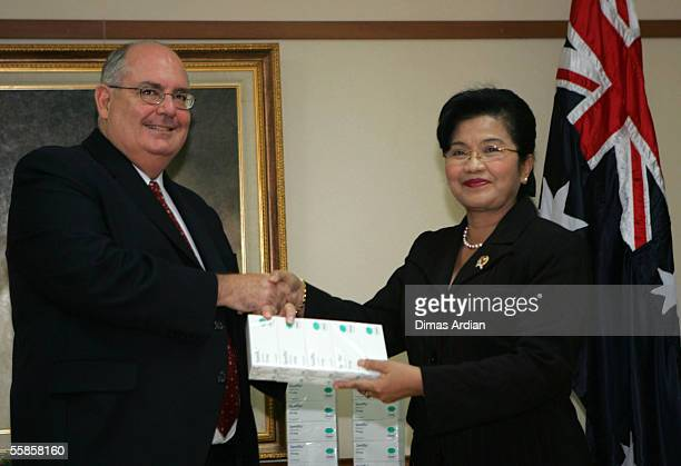 Australian Ambassador David Ritchie gives packs of Tamiflu to Indonesian Health Minister Siti Fadilah Supari at Health Ministry Office October 6 2005...