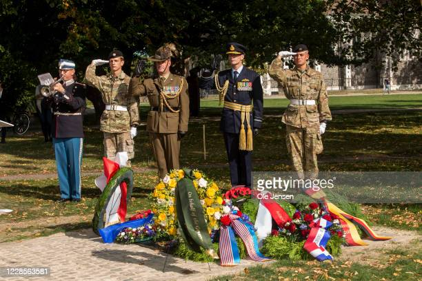 Australian and Danish military personel salutes at the Australian War Monument at the Churchill Memorial Park on September 17 2020 in Copenhagen...