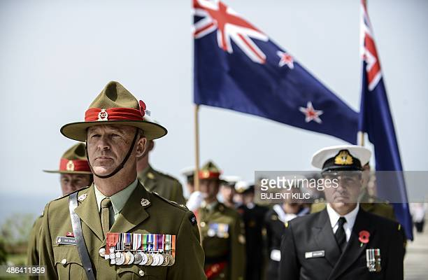 Australian and New Zealand soldiers take stand during the ceremony celebrating the 99th anniversary of the Anzac Day in Canakkale on April 24 2014 A...