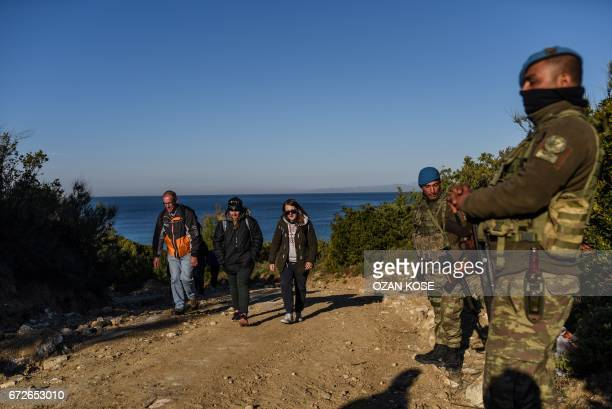 Australian and New Zealandian people arrive to a wreathlaying ceremony at Lone Pine Cemetery in Gallipoli on April 25 2017 to mark the 102st...