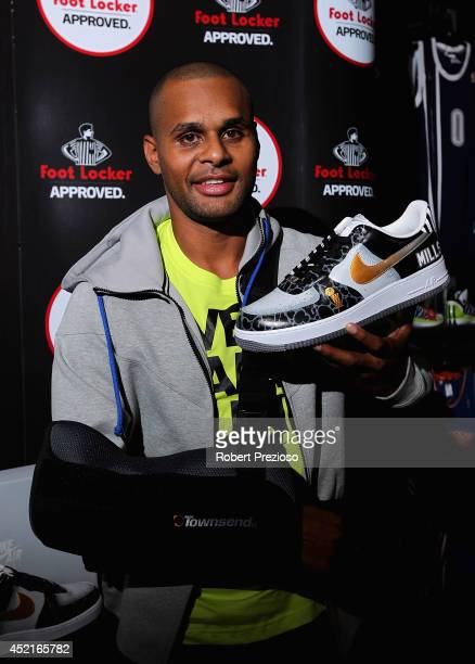 Australian and San Antonio Spurs NBA basketball player Patty Mills poses for photos during a Footlocker in store appearance on July 15 2014 in...