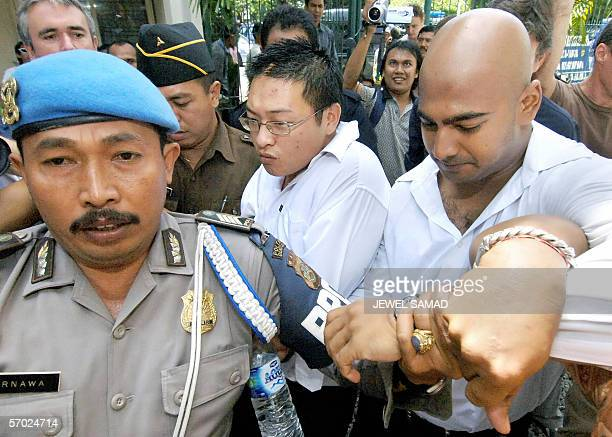 """Australian Andrew Chan and Myuran Sukumaran , the alleged ringleaders of the """"Bali Nine"""" drug ring, are escorted to a court for their trial in..."""