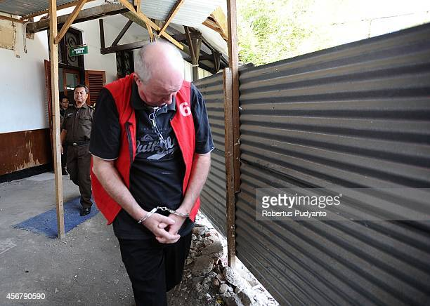 Australian Andrew Roger is escorted by Indonesian Police to a court hearing for drug possession charges on October 7 2014 in Surabaya Indonesia...
