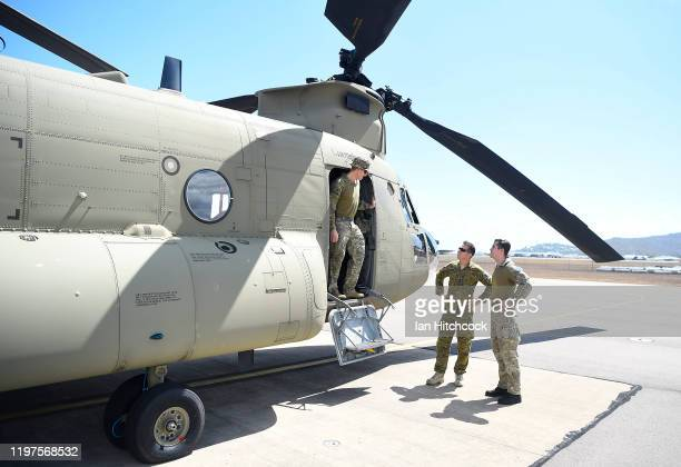 Australian Army Aviation personnel are seen preparing a CH-47 Chinook from the 5th Aviation Regiment before it deploys from Townsville on January 05,...