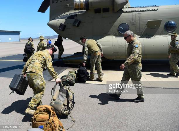Australian Army personnel are seen loading a CH-47 Chinook from the 5th Aviation Regiment before it deploys from Townsville on January 05, 2020 in...