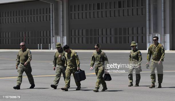 Australian Army personnel are seen walking to a CH-47 Chinook from the 5th Aviation Regiment before it deploys from Townsville on January 05, 2020 in...