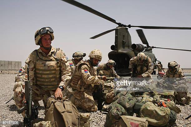 Australian Army soldiers from the 8th/12th Medium Regiment attached to the 7th Parachute Regiment Royal Horse Artillery deploy from a Royal Air Force...