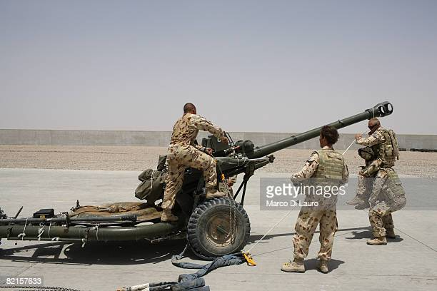 Australian Army soldiers from the 8th/12th Medium Regiment attached to the 7th Parachute Regiment Royal Horse Artillery are seen as they work on a...