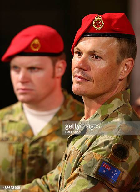 Australian army soldiers look on before entering the field for an Anzac Day tribute during the round six AFL match between the Fremantle Dockers and...