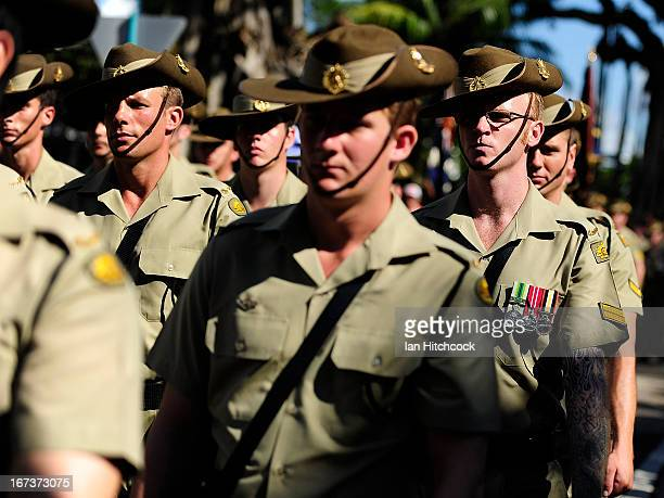 Australian army soldiers march down the strand during the ANZAC Day march on April 25 2013 in Townsville Australia Veterans dignitaries and members...