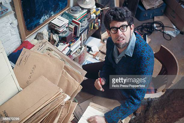 Australian artist and entertainer Rolf Harris pictured working in an office room at home in England in 1968