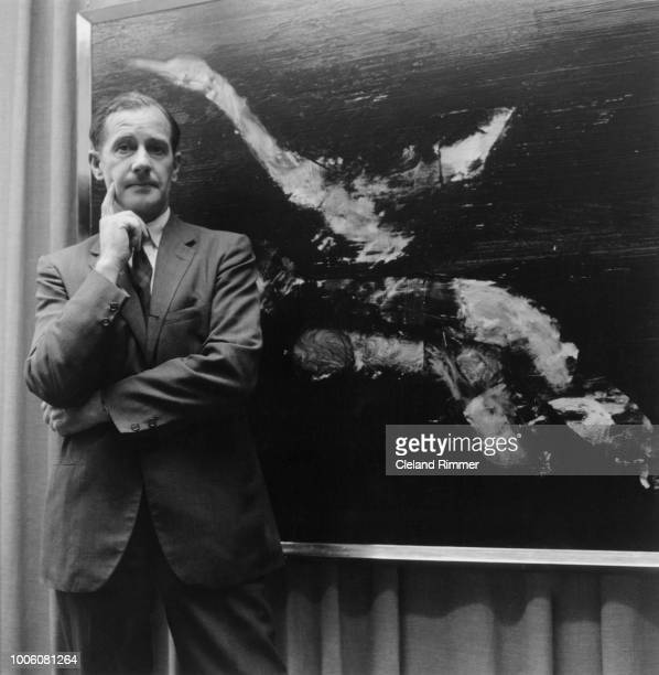 Australian artist Sidney Nolan with one of his series of Leda And The Swan paintings, at the Whitechapel Gallery, London, 20th June 1960.