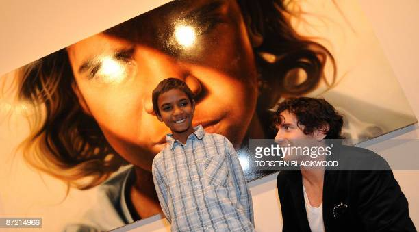 Australian artist Vincent Fantauzzo looks up at his muse after his striking portrait of Aboriginal child actor Brandon Walters won the 2009 Archibald...