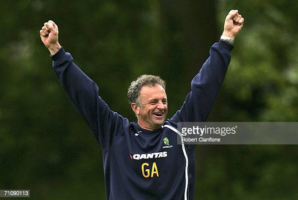 Australian assistant coach Graham Arnold has a laugh with the team members during a training session as Australia prepare for the 2006 World Cup held...