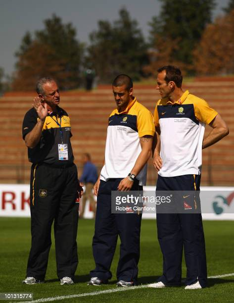Australian assistant coach Graham Arnold talks to goalkeepers Adam Federici and Mark Schwarzer priro to the International Friendly between the...