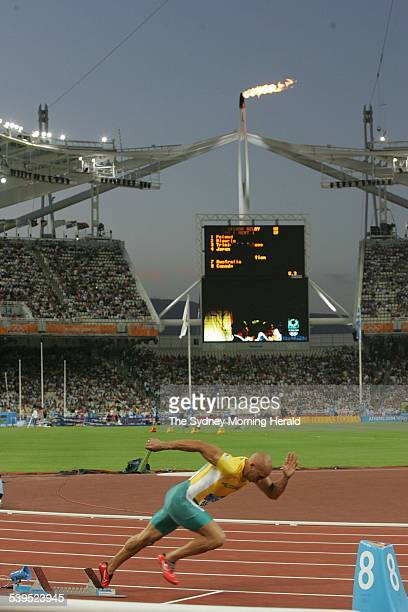Australian athlete Adam Basil jumps out of the starting blocks in the 4 X 100m relay heats at the Athens Olympics August 27 2004 SMH SPORT Picture by...