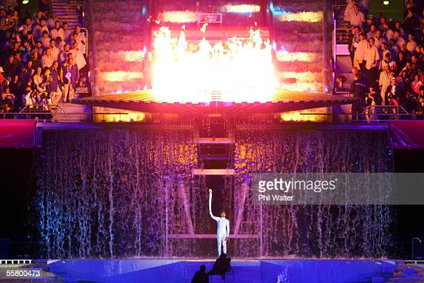 Australian athlete Cathy Freeman stands under the Olympic Flame after lighting it at the conclusion of the opening ceremony of the Sydney 2000...